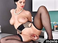 Lingerie hugs every one of Kira Queen's buxom curves from her big breasts to her firm bottom.