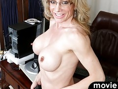 Elizabeth Green is a 41 year old milf with enhanced big boobs that you're going to want to suck and fondle all day long.